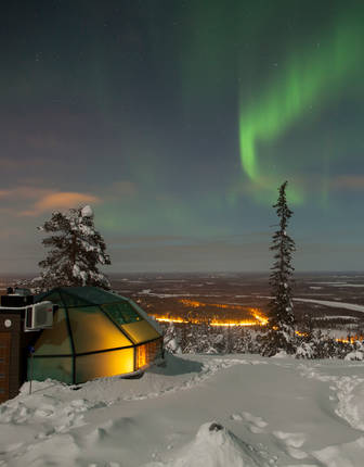 Northern Lights above the glass domes of Levin Iglut