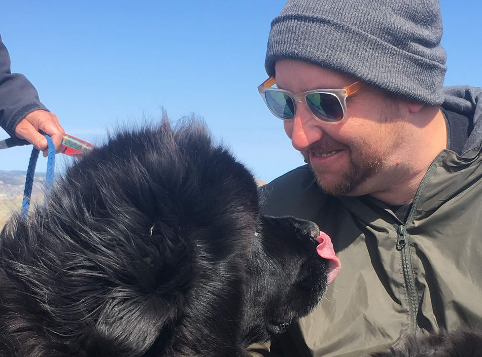 Photo of article author Andy Austen with Newfoundland dog