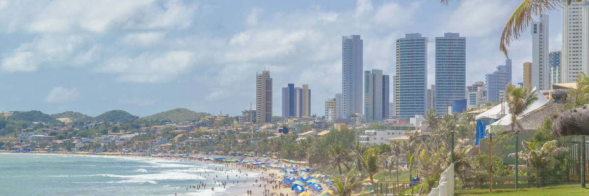 Modern waterfront buildings and paradise beach in Natal, Brazil