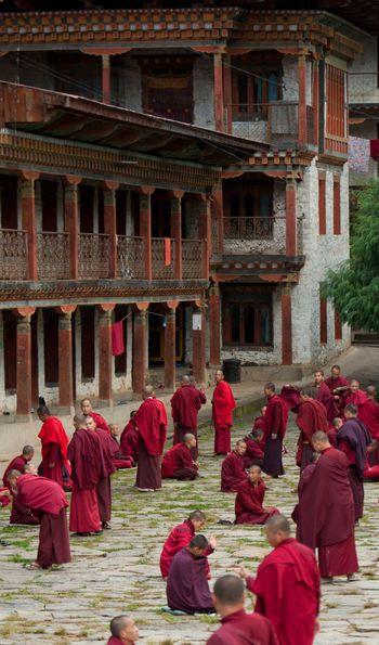 Monks at a Bhutanese dzong, Bhutan