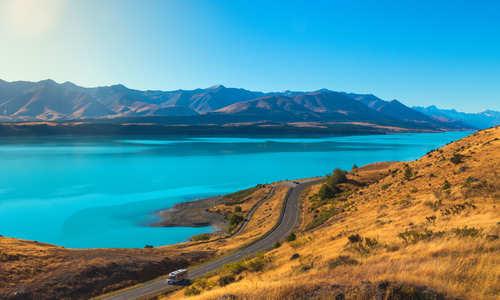 Motorhome driving around Lake Pukaki in New Zealand