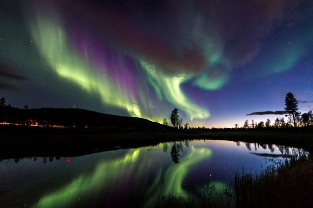 Northern Lights over lake in Levi, Finnish Lapland