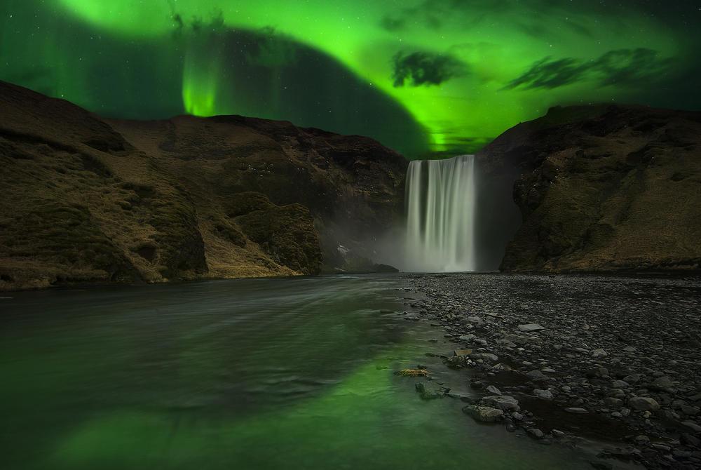 Northern Lights over Skogafoss waterfall, Iceland