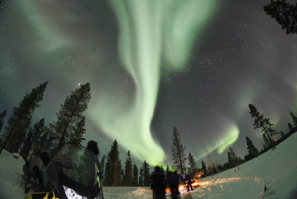Snowmobiling under the Northern Lights, Apukka Resort, Finland