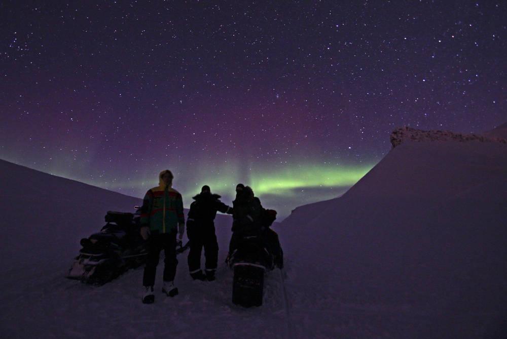 Northern Lights Snowmobiling (Credit: Shutterbird Production/Hurtigruten Svalbard)