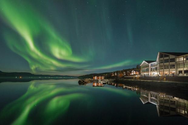 Northern Lights over Malangen Resort. Image by David González Foto