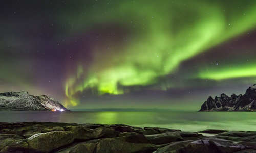 Northern Lights looking out to Steinfjord on Senja island, Norway