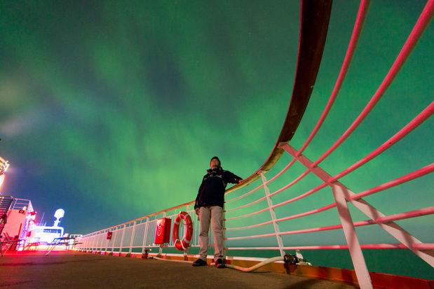 Hurtigruten cruise ship under Northern Lights