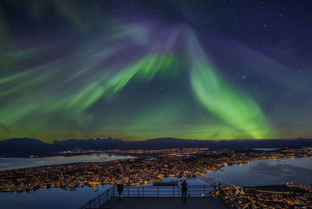 View of the Northern Lights over Tromso from the cable car