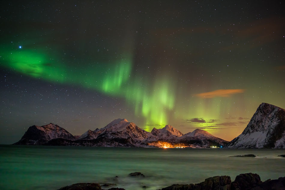 View of the Northern Lights over a village in the Lofoten Islands, Norway