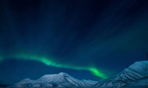 Northern lights in Norway Svalbard in the mountains