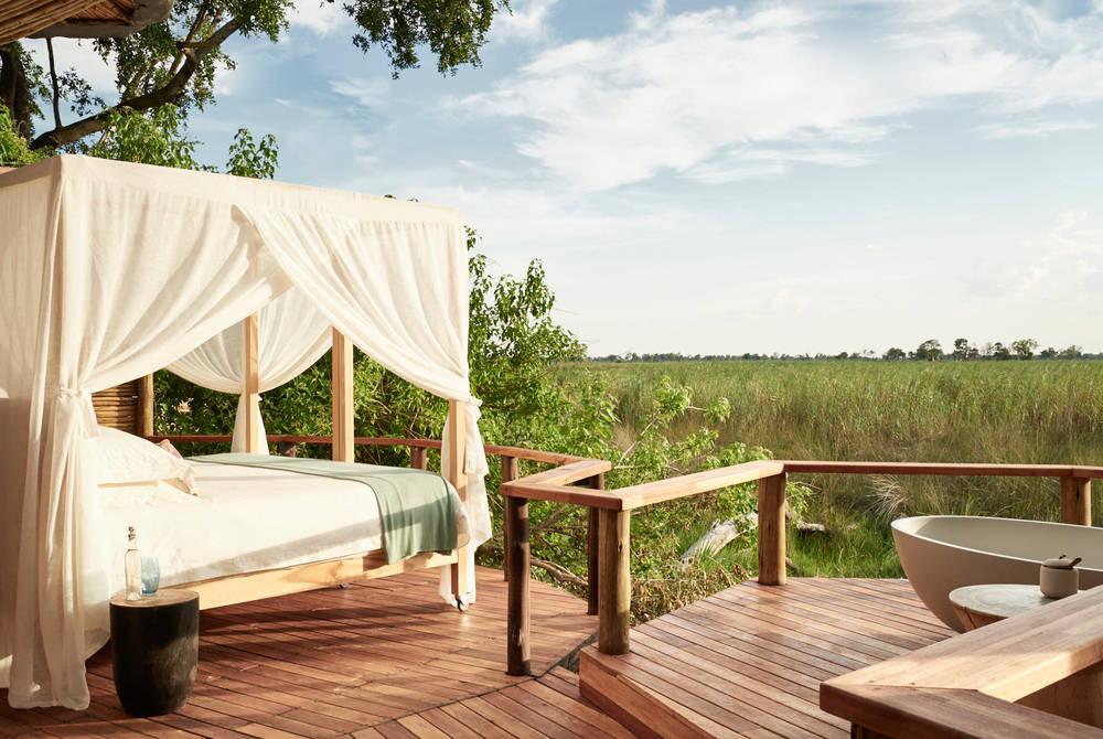 Outdoor bedroom and bath, Sanctuary Baines Camp, Botswana