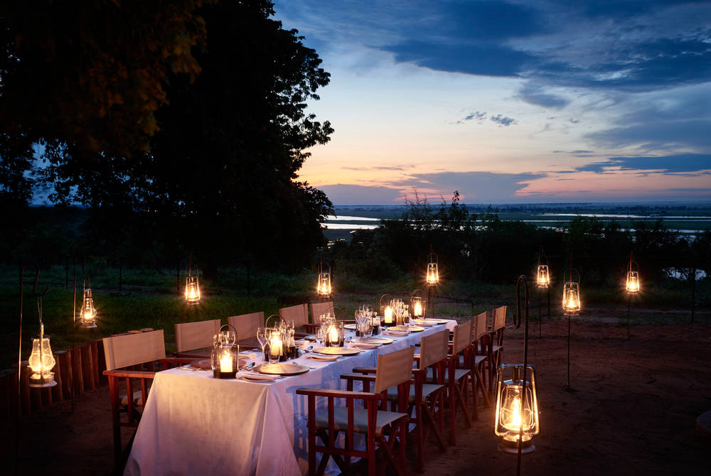 Outdoor dining, Sanctuary Chobe Chilwero, Botswana
