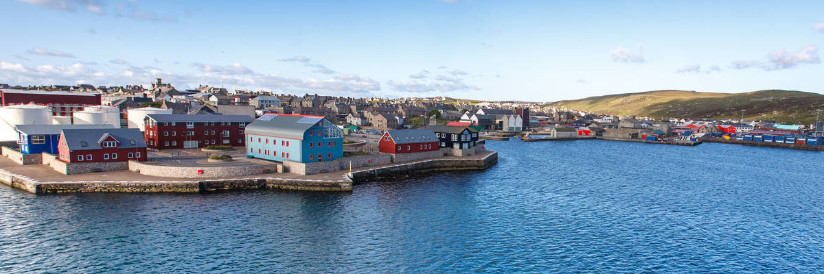 Panorama view of Lerwick town center under blue sky