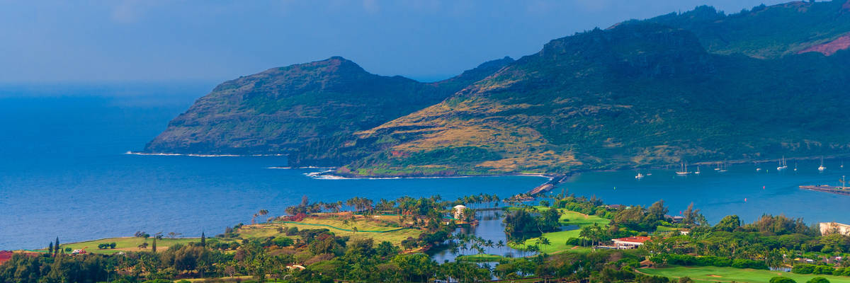 Panoramic aerial view of Nawiliwili Harbor and the Kauai Lagoons Golf Course on Kauai, Hawaii, USA.