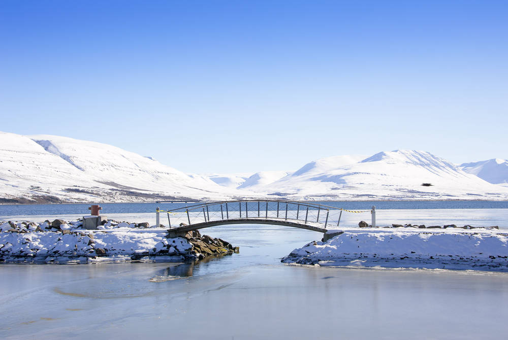 Pedestrian bridge in Akureyri with a view to Eyjafjordur