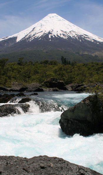 Petrohué Waterfalls in Chile's Lake District Region with Osorno in the background