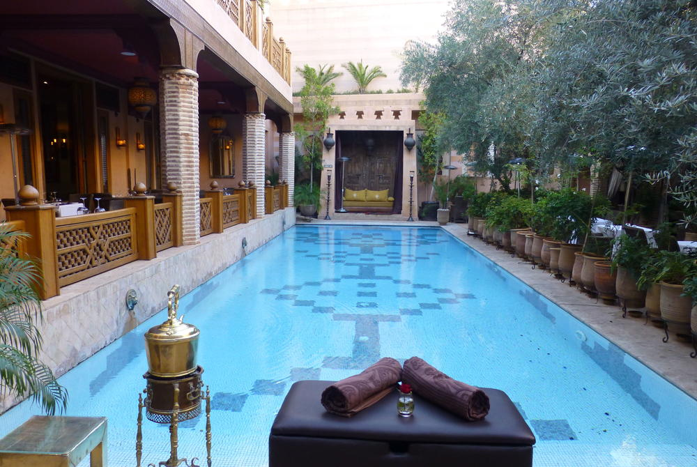 Pool area and dining at La Maison Arabe, Marrakech