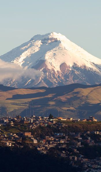 Quito with Cotopaxi volcano in the background