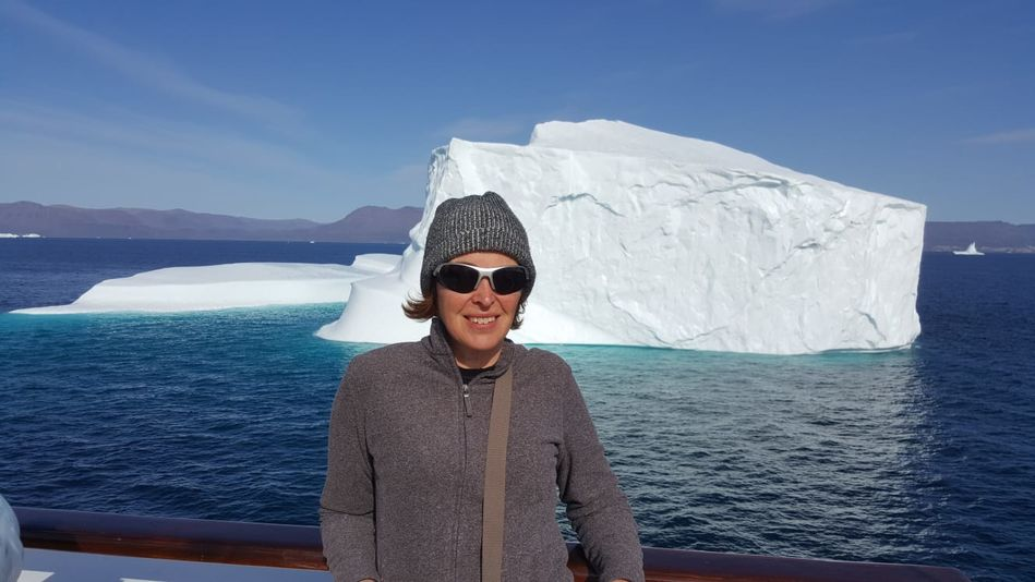 Alison and iceberg, RCGS Resolute, One Ocean Expeditions