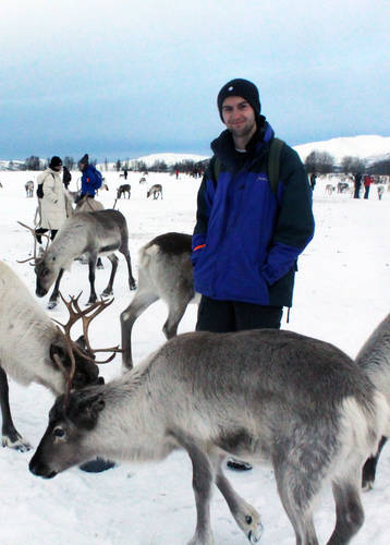 Charlie Pritchard meeting some of Tromso's reindeer