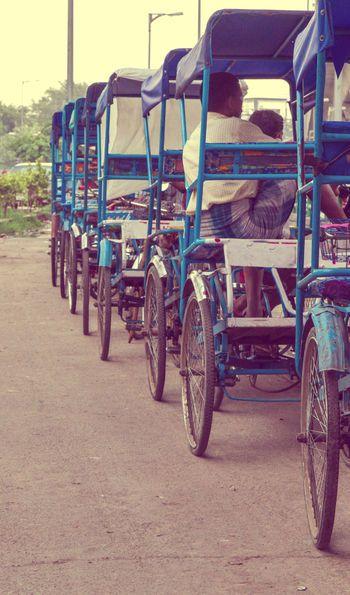 A line of rickshaws in Delhi