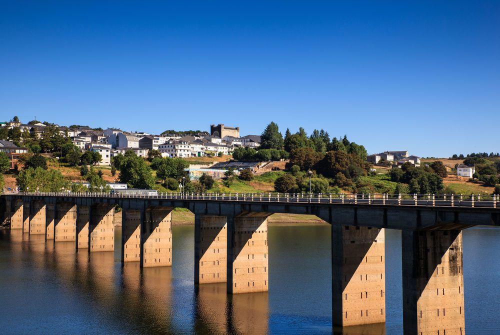 Roman bridge over the Minho River in Portomarin, Spain