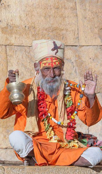 A sadhu, or Hindu holy man, seated on the Varanasi ghats