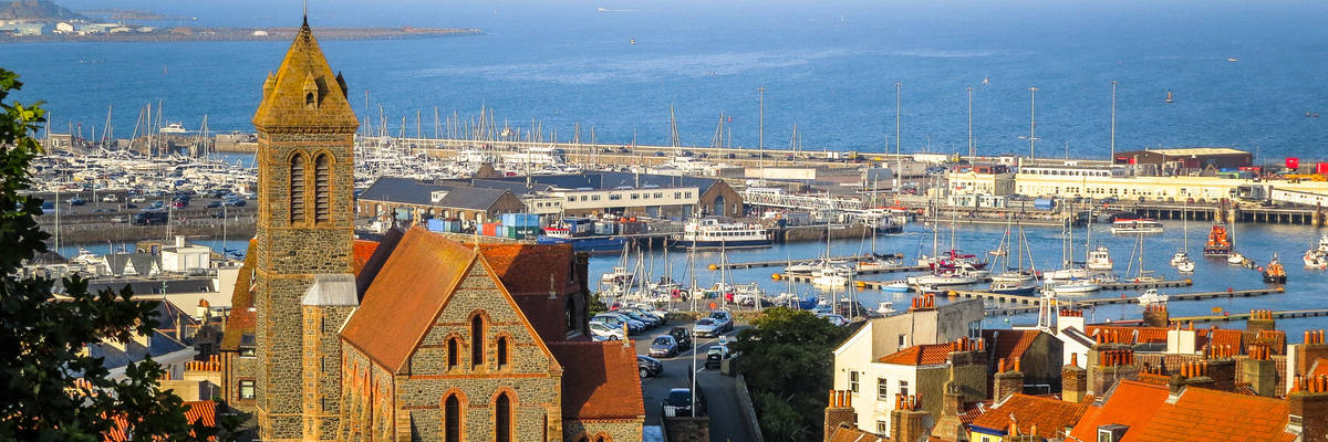 Saint Peter Port at sunrise. Bailiwick of Guernsey, Channel Islands