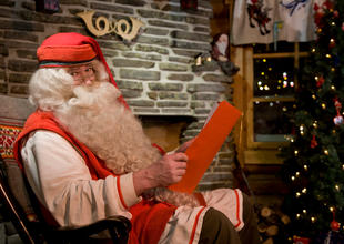 Santa in his post office at Rovaniemi, Finnish Lapland (Credit: Visit Rovaniemi)