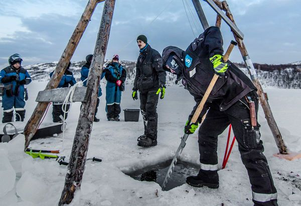 Setting up Ice Fishing, Kirkenes Snowhotel