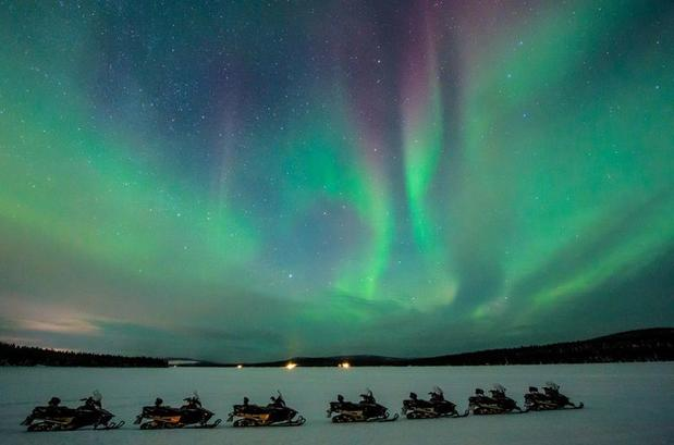 Northern Lights by Snowmobile (Credit- Asaf Kliger © ICEHOTEL)