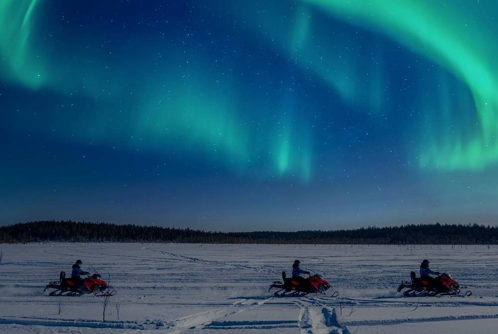 Snowmobiling under the Northern Lights, Apukka Resort, Finland
