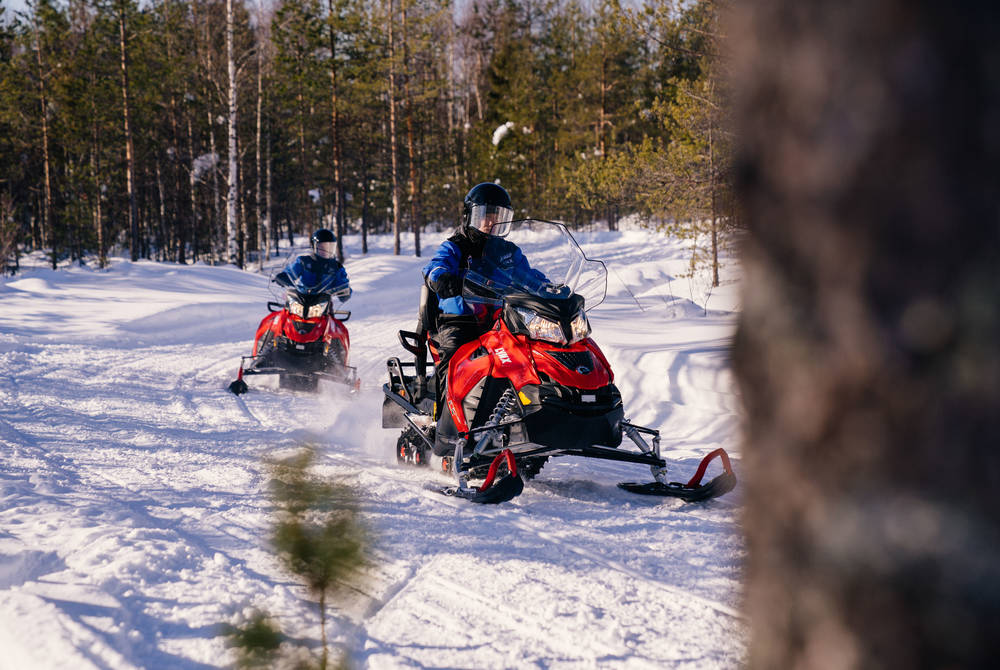 Snowmobiling at Apukka Resort