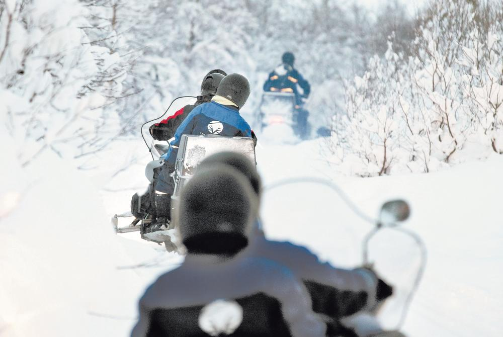 Snowmobiling excursion in Tromso Northern Norway near the Lyngen Alps