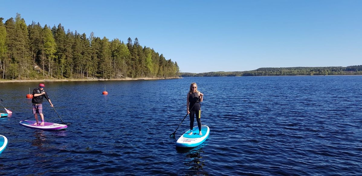 Sophie Sadler stand-up paddleboarding in Finland