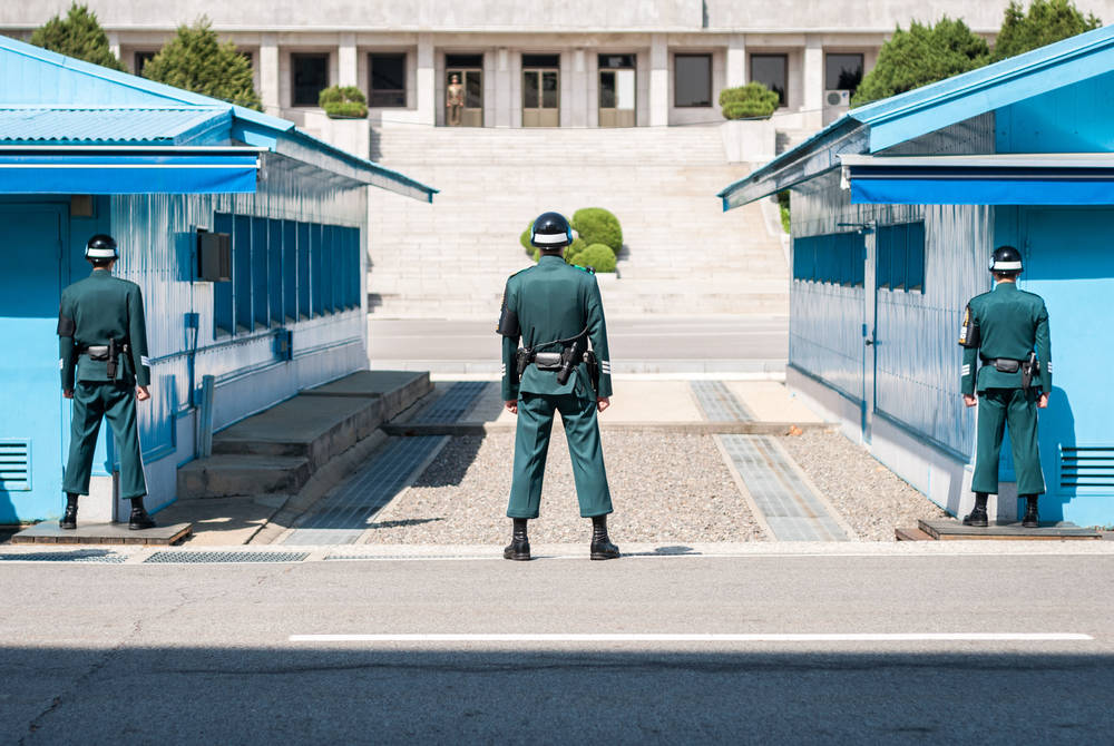 South Korean soldiers looking into North Korea at the DMZ