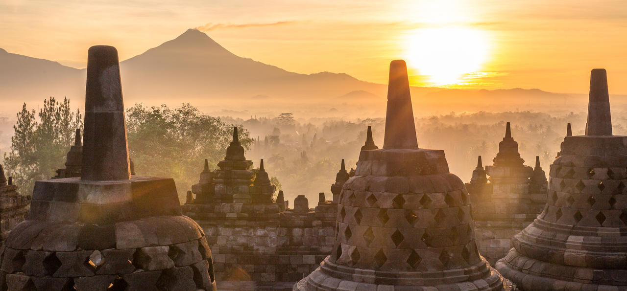 Wake early for sunrise over UNESCO-listed Borobudur – the world's largest Buddhist temple