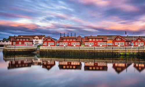 Sunset over harbour houses in Svolvaer