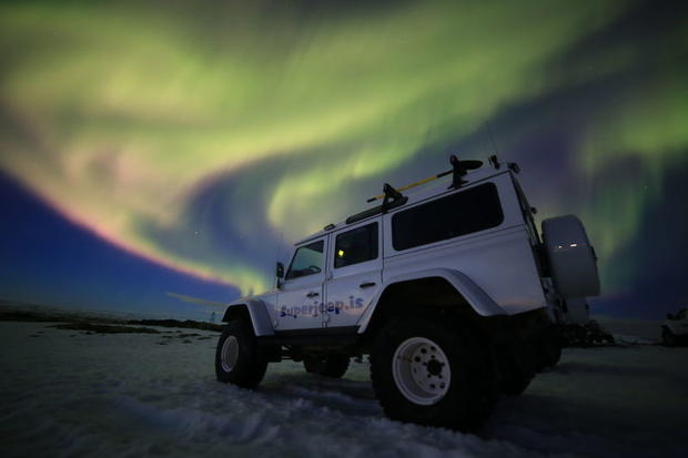 The Northern Lights above a 4WD, Iceland