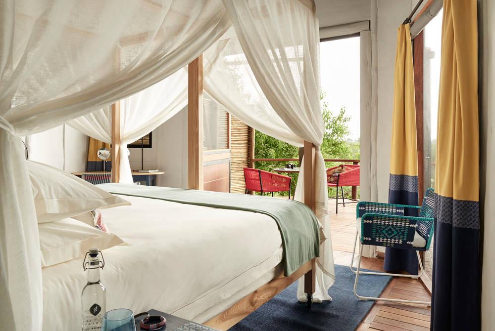 Tented bedroom, Sanctuary Baines Camp, Botswana