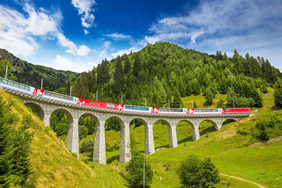 The Glacier Express going over a viaduct in Switzerland