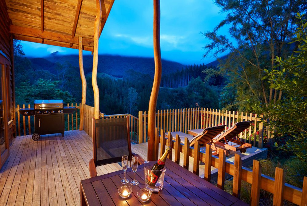 The Resurgence bush chalet deck in the evening, New Zealand