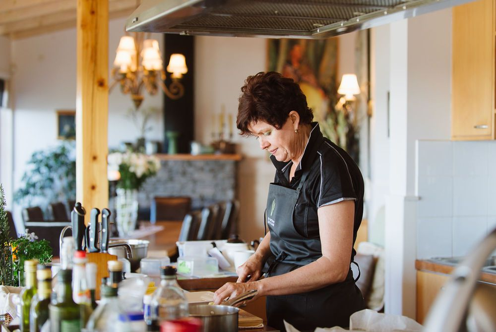 The Sanctuary chef Glennis at work in the kitchen, New Zealand