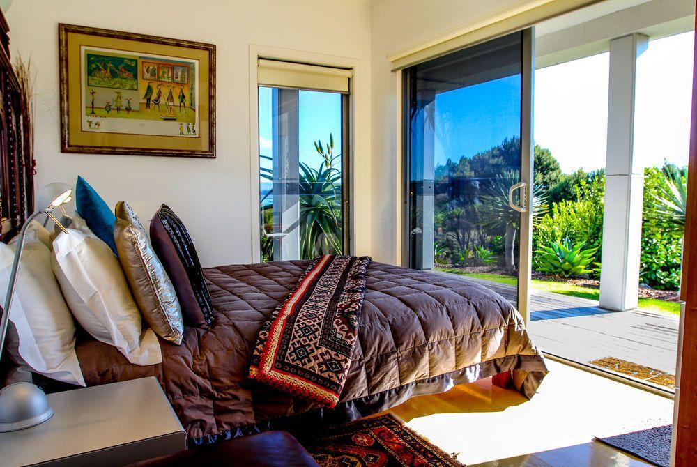 Tiki Tiki Ora bedroom with balcony view, New Zealand