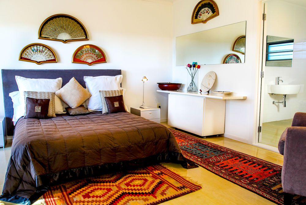 Tiki Tiki Ora bedroom with ensuite, New Zealand