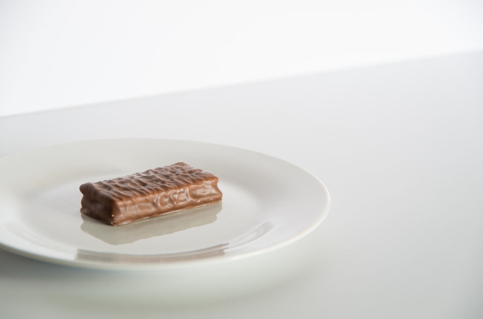 Tim Tam chocolate biscuit on a plate