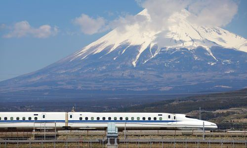 Tokaido Shinkansen bullet train passing Mt Fuji, Japan