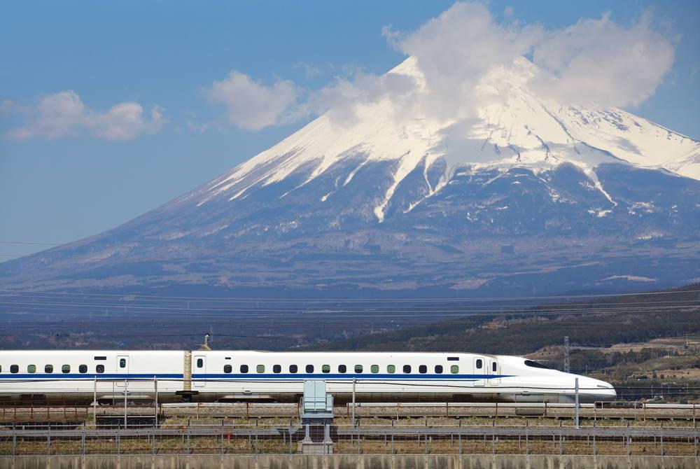 Shinkansen bullet train passing Mt. Fuji