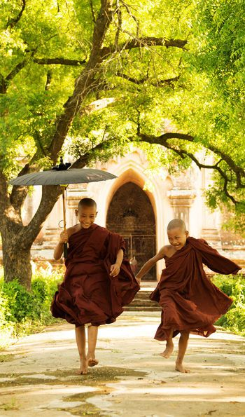Two Monks Running in Burma